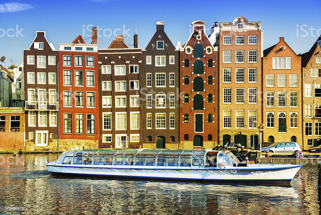 Dutch Houses, Boat and Canal in the Center of Amsterdam royalty-free stock photo