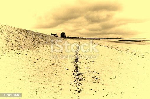The North Sea coast in Zealand, Netherlands. Dutch landscape with view on the dike protects against flooding. Vintage style toned picture