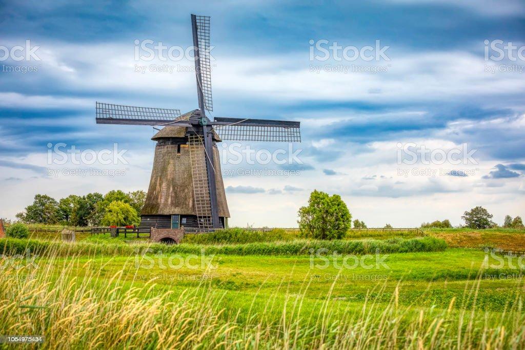 Dutch landscape with the vintage windmill (HDRi) stock photo