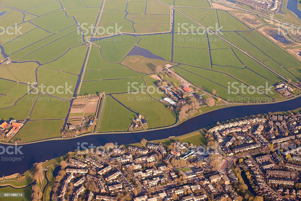 Dutch landscape with village, green fields and canal stock photo