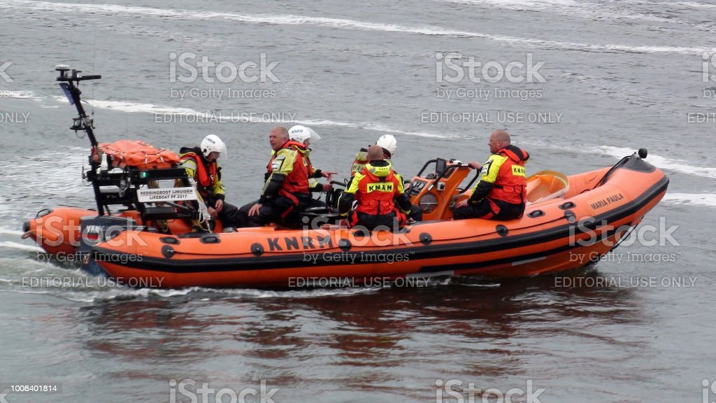 View Of Dutch Search And Rescue Crew Members With Lifeboat Sailing On...