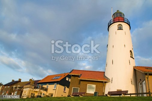 istock Dutch lighthouse and houses in Urk 172374562
