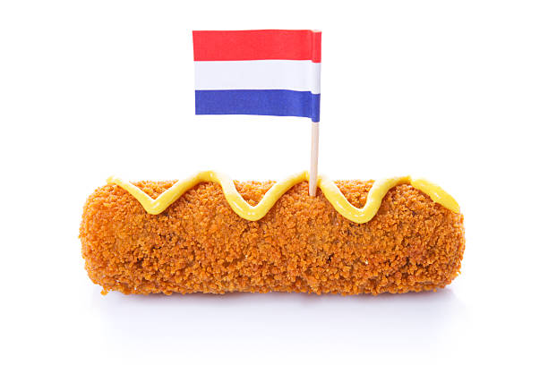 Dutch meat croquette ('kroket'), mustard, Dutch flag, isolated on white stock photo