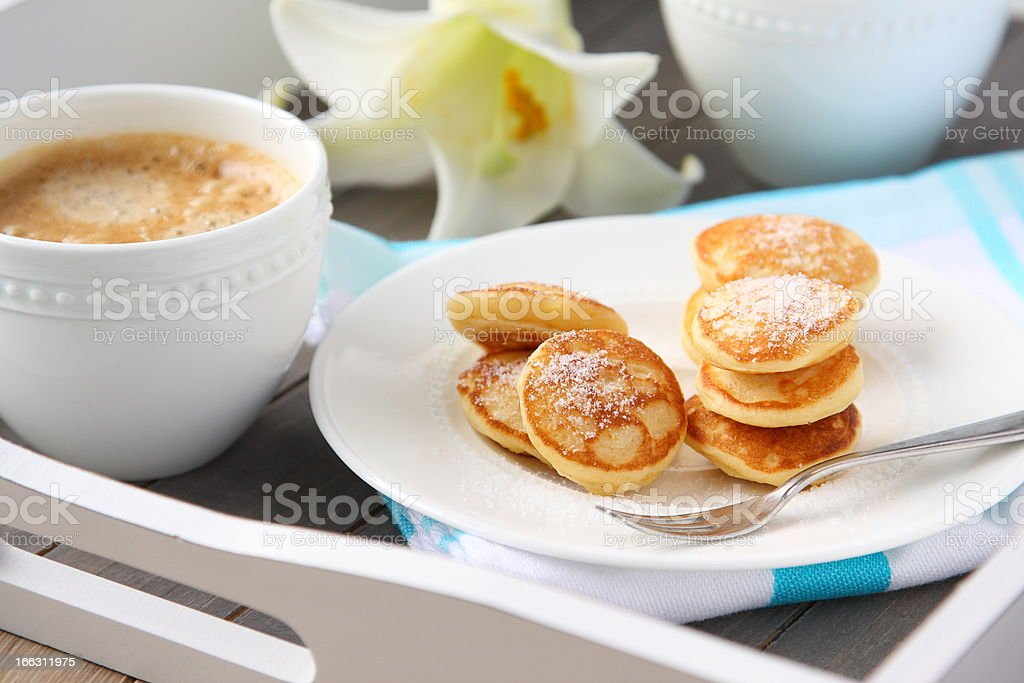 Dutch mini pancakes called poffertjes royalty-free stock photo