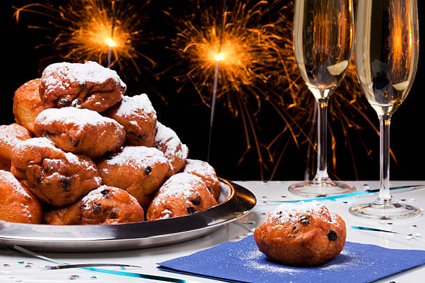 dutch new year's eve with oliebollen, a traditional pastry - oliebollen stockfoto's en -beelden