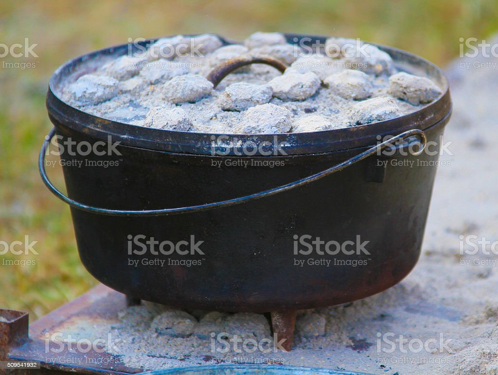 Dutch Oven Cooking with Coals - Stock Image stock photo