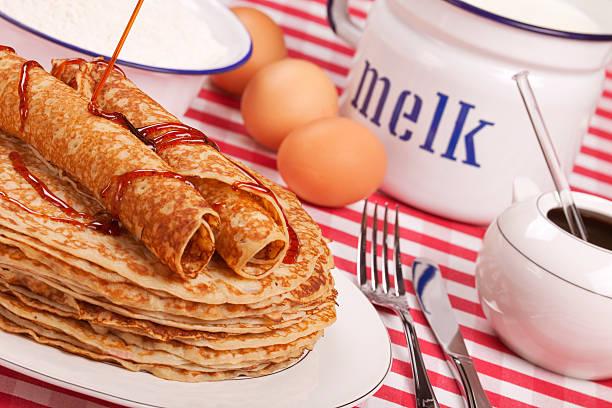 Dutch pancakes with syrup or 'pannenkoeken met stroop' stock photo