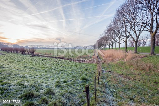 1034754000istockphoto Dutch polder landscape in the winter season 992347722