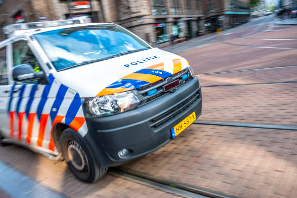 Dutch police car rushing to the scene of an incident in Amsterdam stock photo