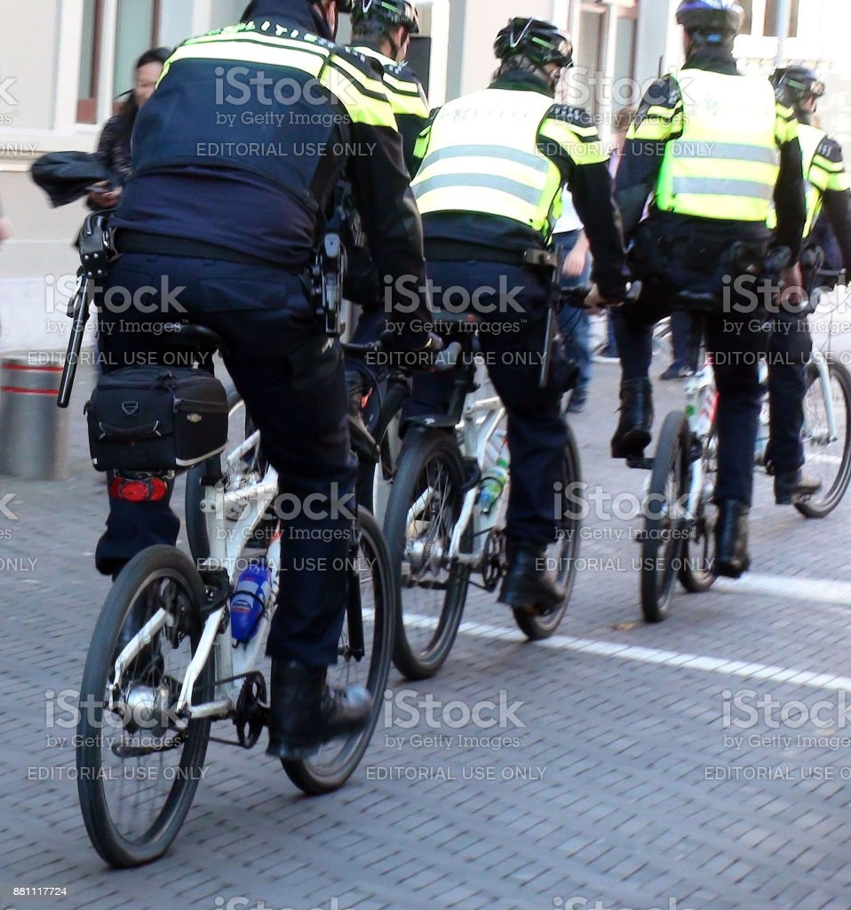 Dutch Police Officers On Bicycle Scene In The Hague South Holland The Netherlands Europe stock photo