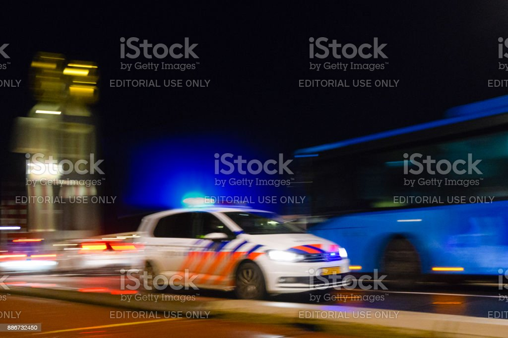 Dutch policecar rushing to the scene of an accident - foto stock