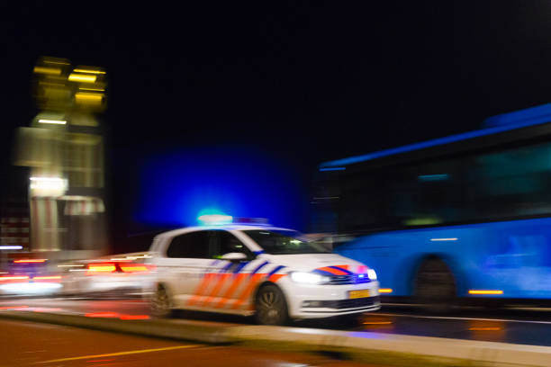 Dutch policecar rushing to the scene of an accident stock photo