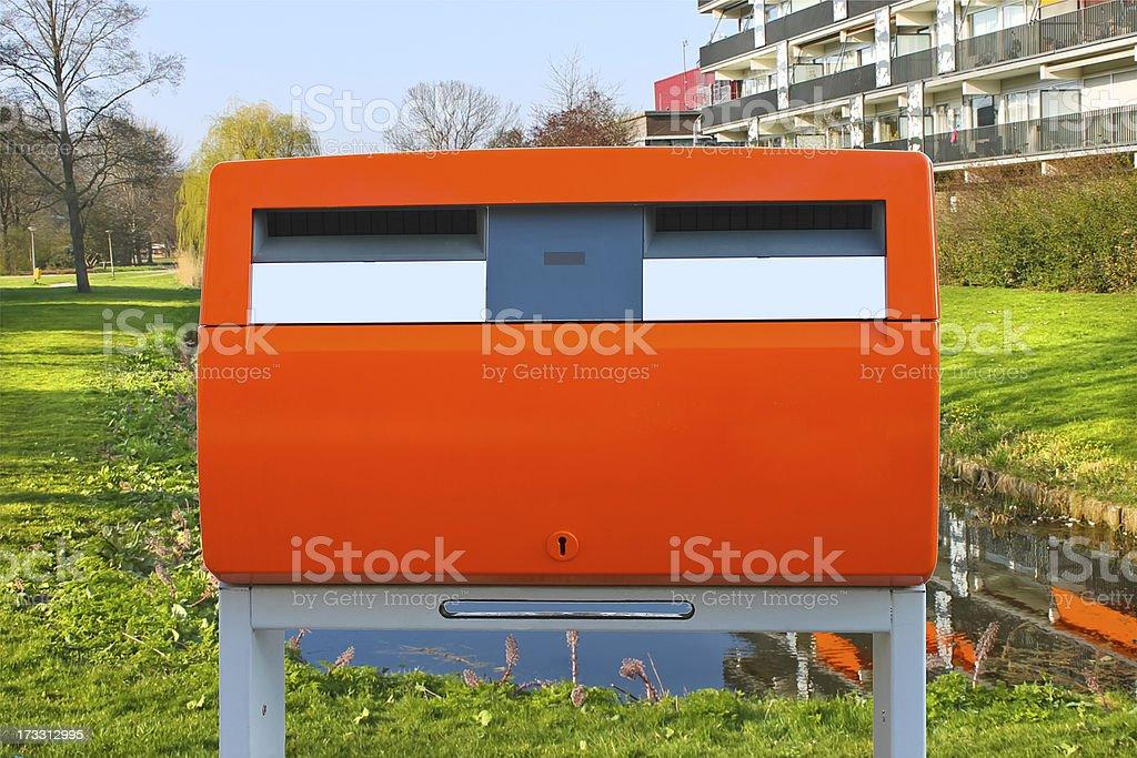 Dutch public orange mailbox on a city street. Netherlands royalty-free stock photo