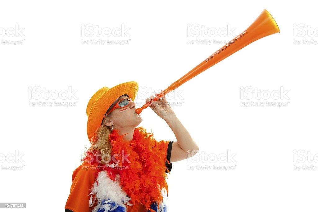 Dutch soccer supprter with plastic vuvuzela stock photo