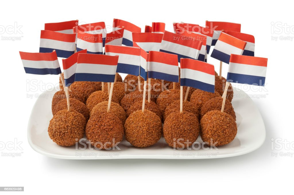 Dutch traditional snack bitterballen on a dish with a dutch flag stock photo