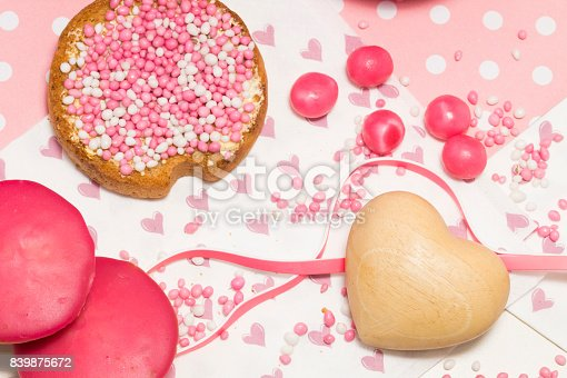 istock dutch white and pink sprinkles  with crispy biscuit, wooden heart and cake with sweet fondant 839875672