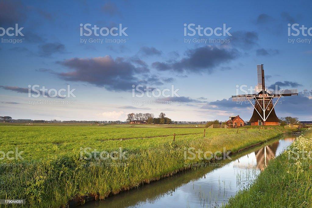 Dutch windmill at sunrise stock photo
