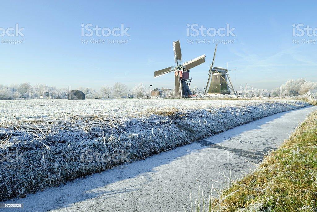 Dutch windmills in winter landscape royalty-free stock photo