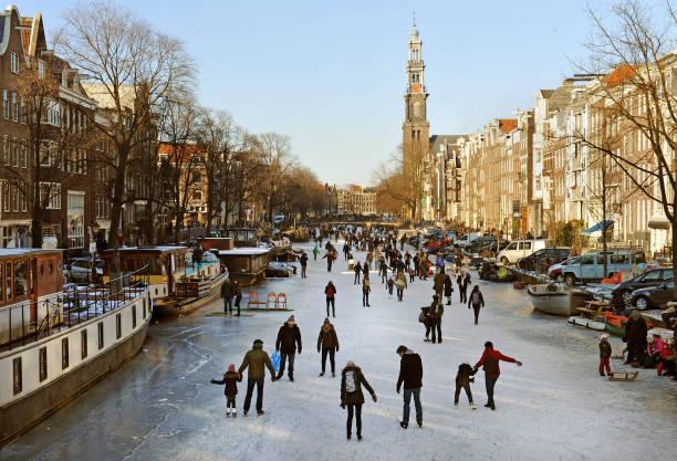 dutch winter scene - westerkerk stockfoto's en -beelden