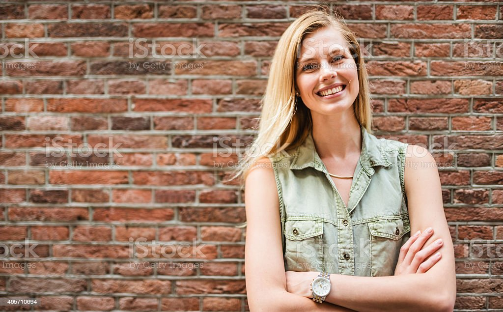 Dutch woman portrait against a brick wall stock photo