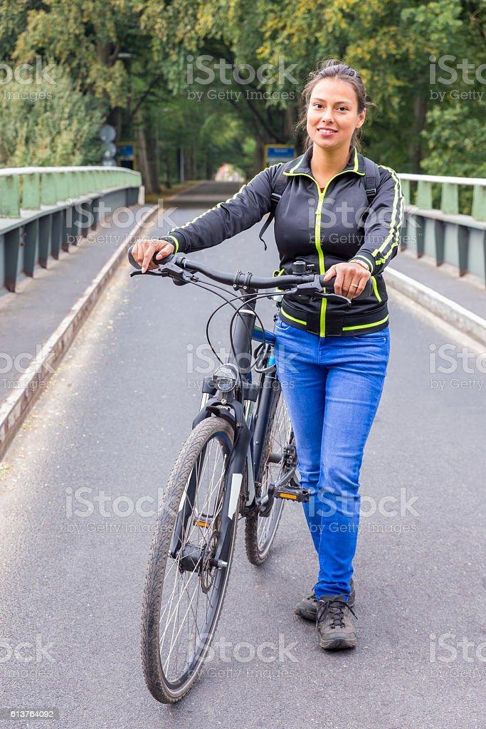 Dutch woman standing with ATB mountainbike on bridge stock photo