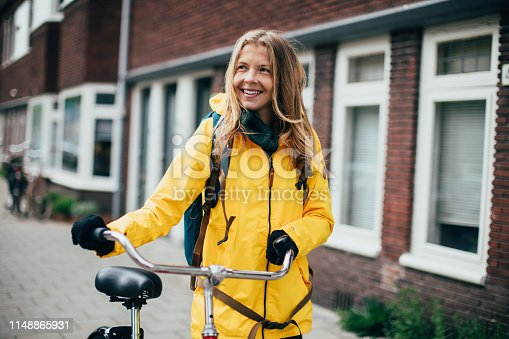 Dutch woman with bicycle in Amsterdam