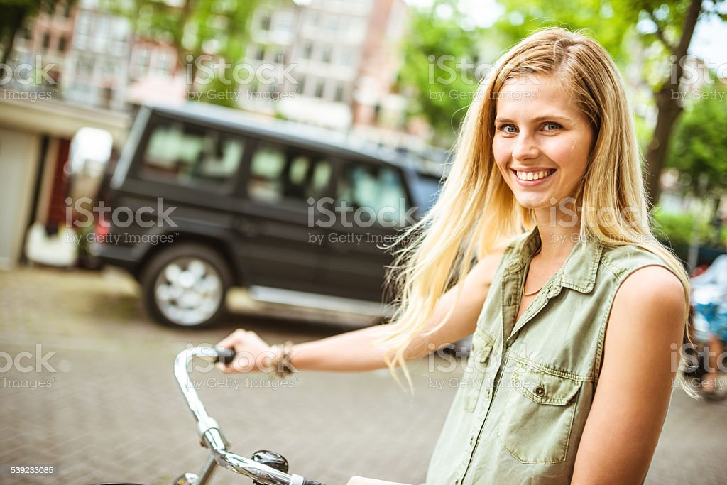 Dutch woman with bicycle in amsterdam royalty-free stock photo