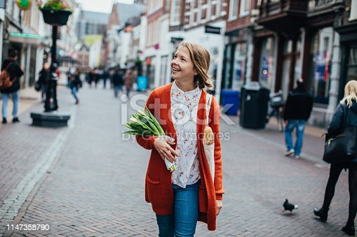 Dutch woman with tulips in Utrecht
