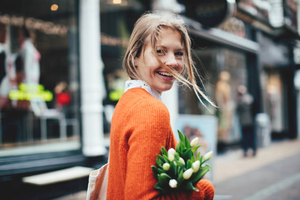Dutch woman with tulips in Utrecht Dutch woman with tulips in Utrecht nederland stock pictures, royalty-free photos & images