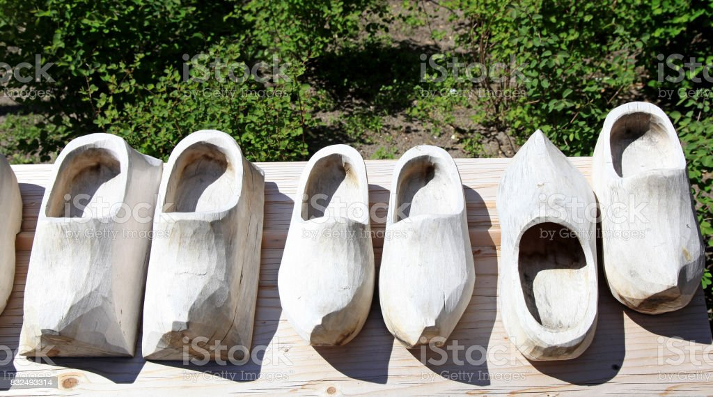Dutch wooden shoes on a wood background. stock photo
