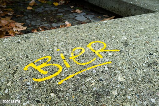 istock Dutch word for beer written on concrete 505018176