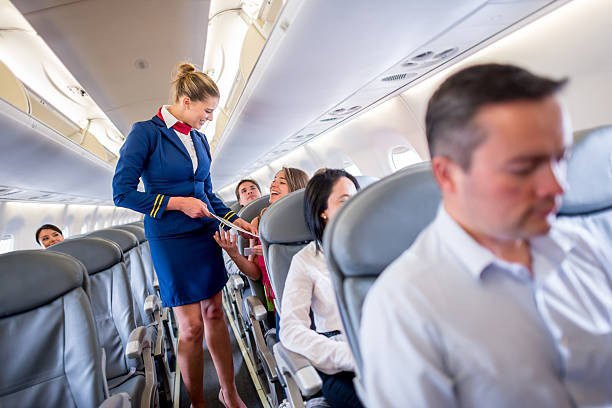 Duty free service onboard People shopping from the duty free service onboard cabin crew stock pictures, royalty-free photos & images
