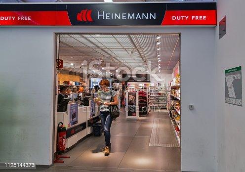 BERLIN, GERMANY - JULY 15, 2018: Passengers buy tax free goods in Heinemann Duty Free shop in Tegel Otto Lilienthal international airport. Tegel is the main international airport of Berlin.
