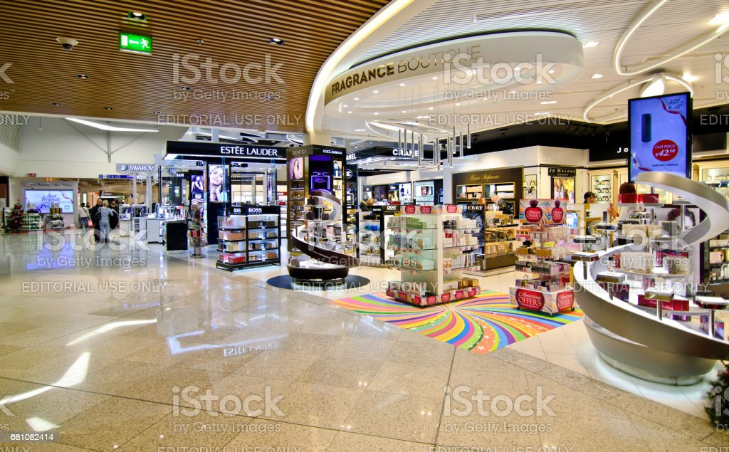 duty free shops at Eleftherios Venizelos airport in Athens Greece ATHENS GREECE AIRPORT, DECEMBER 13 2015: duty free shops at Eleftherios Venizelos airport in Athens Greece, swarovski, lancome, dior shops, Editorial use. Advertisement Stock Photo