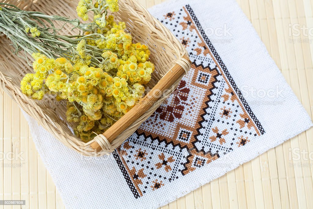 Dwarf everlast flowers bouquet in a wicker basket royalty-free stock photo