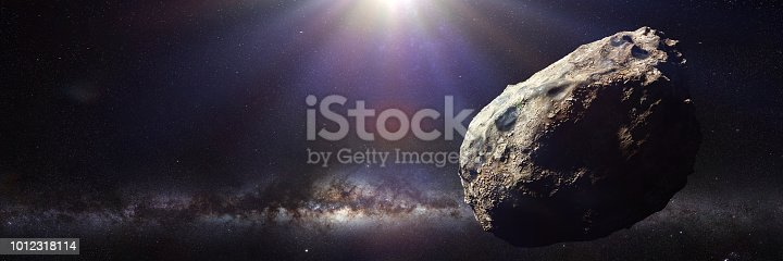 istock dwarf planet of the asteroid belt lit by Sun and the galaxy 1012318114