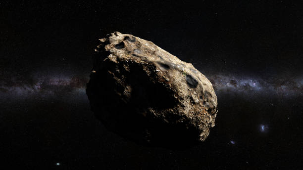 dwarf planet of the asteroid belt lit by Sun and the galaxy stock photo