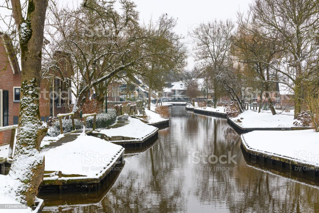 Dwarsgracht Near Giethoorn Village With The Canals With Snow During
