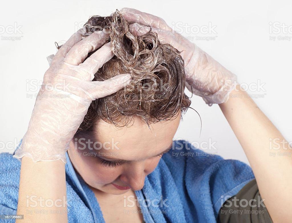Dye hair - portrait of woman coloring her hair