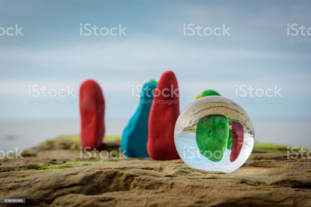 Dyed stones at coast stock photo