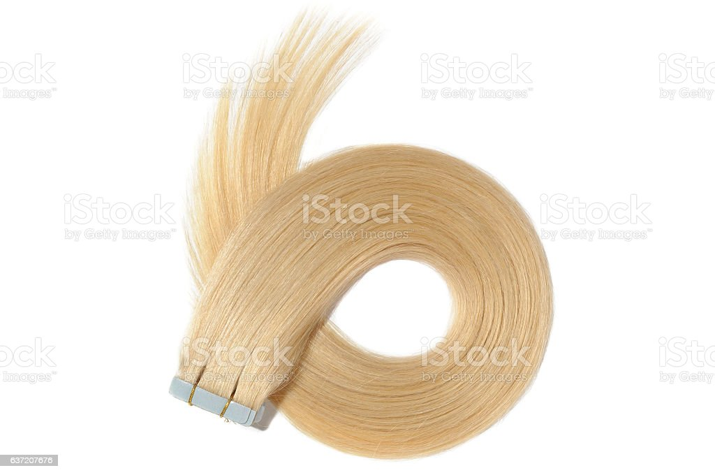 Dyed straight creamy blonde adhesive tape in human hair extensions - foto de acervo