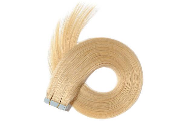 dyed straight creamy blonde adhesive tape in human hair extensions - haarverlängerung stock-fotos und bilder
