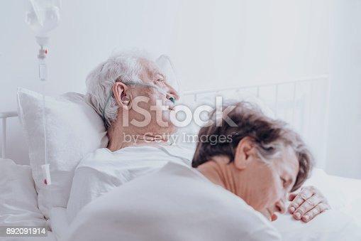 902077950istockphoto Dying elderly man at hospital 892091914