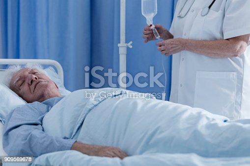 909569706 istock photo Dying senior patient 909569678