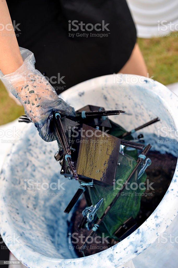 Dying Shibori Cloth stock photo