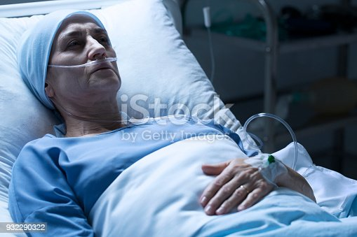 910488902istockphoto Dying woman in hospital 932290322