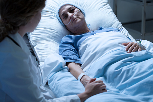 istock Dying woman with nurse 932290316