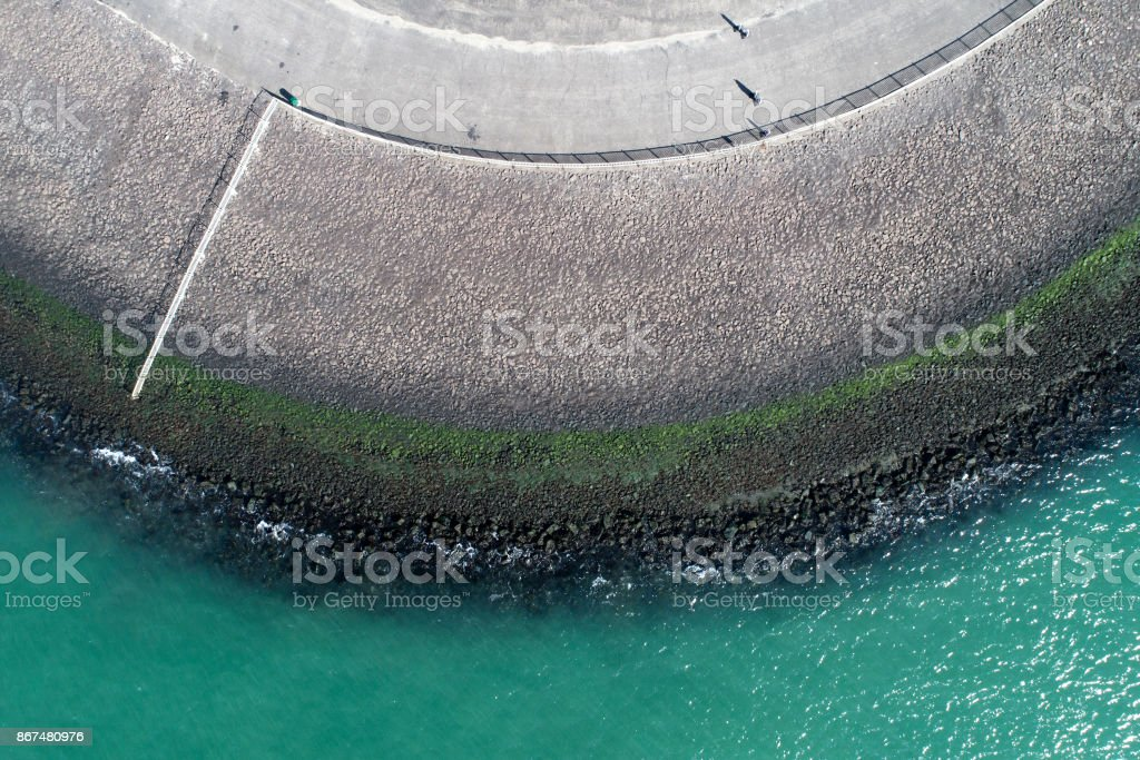 Dyke and coastline - aerial view stock photo