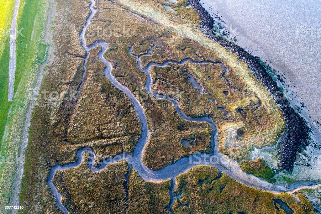 Dyke, salt marsh and coastline - aerial view stock photo