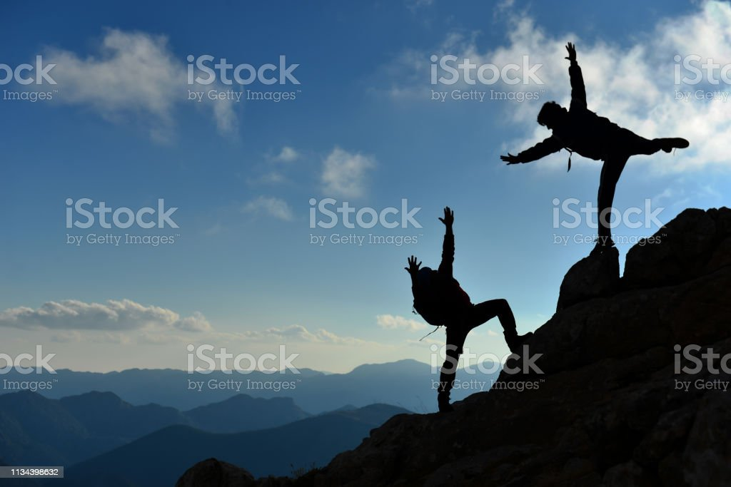 dynamic and enthusiastic climber team stock photo